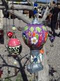 Purple Turkish Ottoman Style Hot Air Balloon Figure From Cappadocia. Purple Turkish Ottoman-style hot air balloon figure hanging from a tree in Cappadocia Royalty Free Stock Image