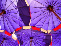 Purple umbrella. And structure on the beach Stock Photo