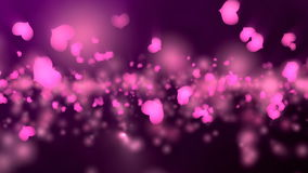 Purple Valentine`s Day Animation. Valentine`s day animation, flying hearts and particles. Seamless loop background stock video