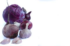 Purple vegetables on white background royalty free stock photography