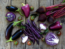 Purple vegetables on a wooden background Royalty Free Stock Image