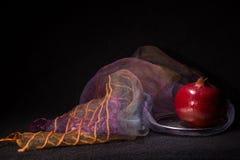 Purple veil and ripe pomegranate Stock Images