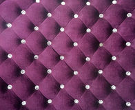 Purple velet button fabric Royalty Free Stock Image