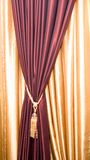 Purple velvet courtain with tassel. Purple velvet curtain with golden tassel Stock Images
