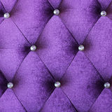 Purple velvet cushion Stock Image