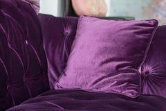 Purple velvet pillows on the sofa Royalty Free Stock Image