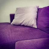 Purple velvet sofa with cushions Stock Image