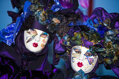 Purple Venetian costumes Stock Photos