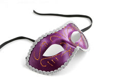 Purple Venetian Mask. Close Up of Purple Venetian Mask with Gold Trim and Black Satin Ties on White Background with Soft Shadow stock images