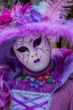 Purple Venice Mask. Silver grey venice carnival mask feather flower gem Stock Images