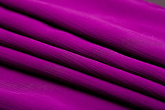 Purple, violet tender colored textile, elegance rippled material. Fabric and tissue Stock Photos