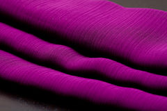 Purple, violet tender colored textile, elegance rippled material Stock Images