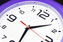 Purple wall clocks Royalty Free Stock Photography