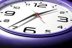 Purple wall clocks Stock Photo