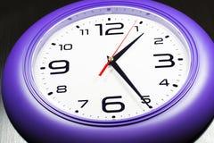 Purple wall clocks Stock Images