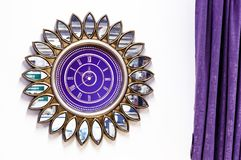 Purple watch in the form of a flower with mirror petals royalty free stock photos