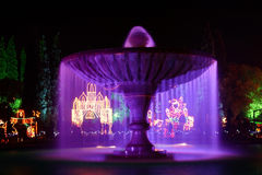 Purple water fountain Royalty Free Stock Photos