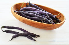 Purple wax snap bean. Bunch of purple wax snap beans in rustic bowl in horizontal format Royalty Free Stock Images