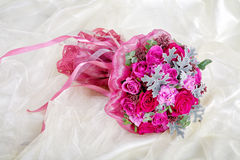 Purple wedding bouquet on a t fabric Stock Photography