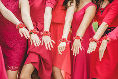 Purple wedding bracelets and hands girlfriends Stock Photo