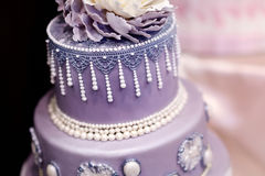 Purple wedding cake decorated with flowers Royalty Free Stock Photo