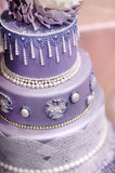 Purple wedding cake decorated with flowers Royalty Free Stock Image