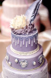 Purple wedding cake decorated with flowers Royalty Free Stock Images