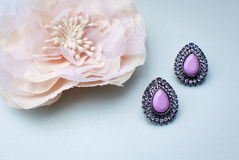 Purple wedding earrings Royalty Free Stock Images
