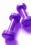 Purple weights. A couple of 3 kg weights, blue toned Stock Image