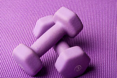 Purple weights yoga mat Royalty Free Stock Photos