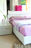 Purple and white bed with outdoor light Royalty Free Stock Images