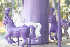 Purple and white carousel with moving exposure. And radial bokeh Stock Photo
