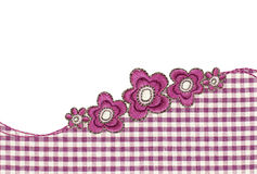 Purple and white checkered fabric with embroidered flowers Stock Photography