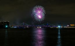 Purple and White Firework Explosion over City Bridge, Philadelphia stock photos
