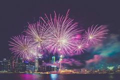 Purple and White Fireworks in the High Buildings Stock Photography