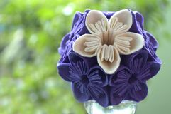 Purple and white origami kusudama flower. On natural background royalty free stock photos
