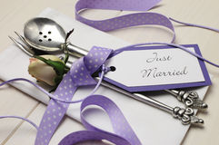 Purple and white shabby chic wedding table setting. Close up.