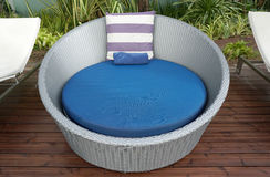 Purple and white stripe cushion on blue beach bed Royalty Free Stock Photos