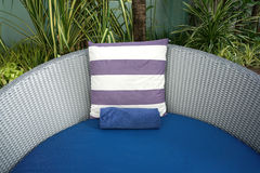 Purple and white stripe cushion on blue beach bed Royalty Free Stock Image