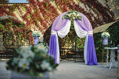 Purple white wedding arch otdoor Stock Photos