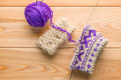 Purple and white woolen yarn and knitted socks with a pattern Stock Image