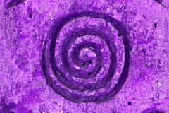 Purple wind vortex spiral ornament on the wall texture Royalty Free Stock Photos