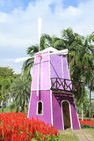 Purple windmill in garden Royalty Free Stock Images