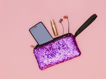 Free Purple Women`s Handbag With Phone Lipstick And Headphones On A Pink Table. Pastel Color. Flat Lay. Royalty Free Stock Photos - 122767208