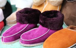 Purple wool slippers for sale at market Royalty Free Stock Photos