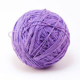 Purple wool yarn ball Royalty Free Stock Photos