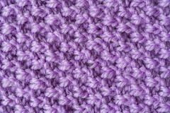 Purple woolen yarn as texture. Close up view of a purple woolen yarn as texture background, abstract Stock Image