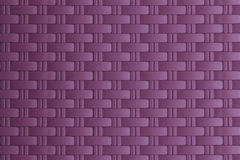 Purple woven carbon fibre  textured Royalty Free Stock Images