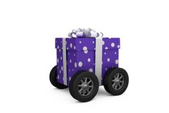 Purple wrapped with polka dot gift box on wheels Royalty Free Stock Image