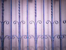 Purple Wrought iron fence Stock Photo